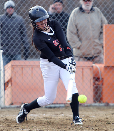 Beverly's Ally Cabral makes solid contact off Malden starting pitcher Alexis Brown during the third inning of play on Thursday afternoon. DAVID LE/Staff photo. 4/17/14