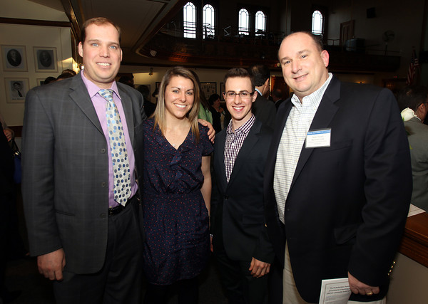 From left: Christian Hassel and Lindsey Sonn from Cataldo Ambulance Service, and Anthony Trifone and 2014 Business Leadership Award recipient John Tynan, from Burton's Grill. The 22nd annual Ferrin Community Service Awards were given out on Wednesday evening in the Wiggin Auditorium inside Peabody City Hall. DAVID LE/Staff photo 4/2/14