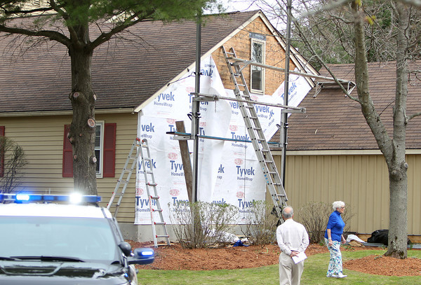 Two workers from Pergola Construction were taken to the hospital after the scaffolding they were standing on collapsed while working on the siding of one of the condominiums located at 141 Village Post Road in Danvers on Tuesday afternoon. DAVID LE/Staff photo. 4/22/14