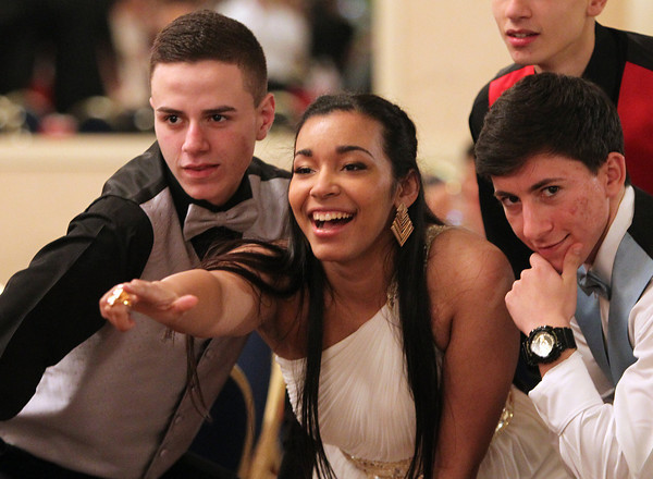Salem High School students Brandon Mustafaraj, Jami Nova, and Alesio Kanani pose for a photo at Salem High School's junior prom held at the Peabody Marriott Hotel on Friday evening. DAVID LE/Staff photo 4/4/14