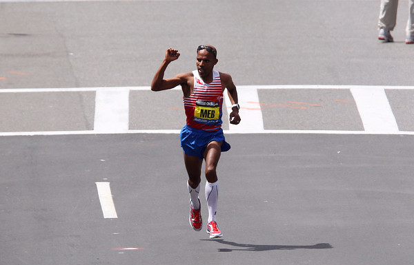 Meb Keflezighi pumps his fist as he cruises to the finish line of the 118th Boston Marathon for a first place finish in 2:08:37. DAVID LE/Staff photo 4/21/14
