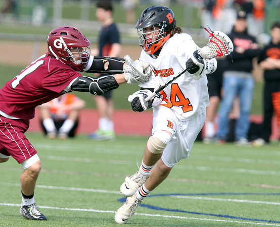 Beverly sophomore midfielder Jordan Rawding (34) evades a check from Gloucester Cormac Flickinger (11) and rifles a shot on net for his first goal of the game. DAVID LE/Staff photo. 5/1/14