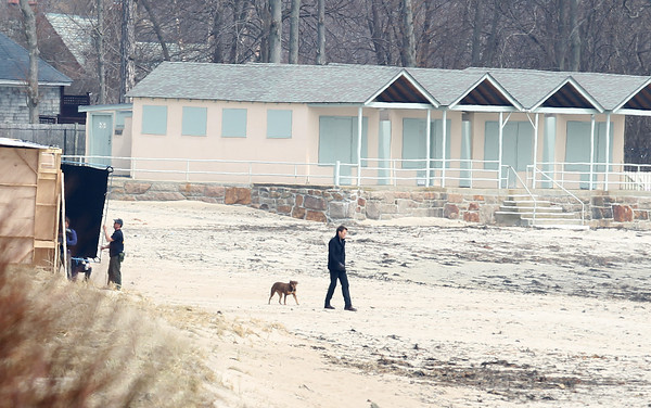 New England Patriots quarterback Tom Brady walks across West Beach in Beverly Farms on Friday afternoon while filming an Uggs commercial. DAVID LE/Staff photo 4/11/14