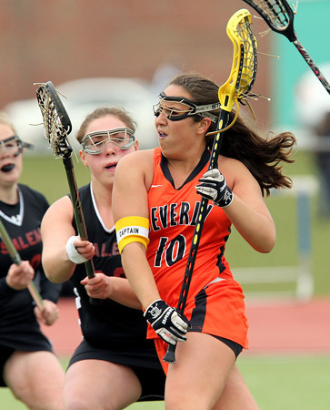 Beverly junior captain Camden Vitale (10) sprints past Salem defender Gabby Rocheville and drives hard to the net to score a first half goal on Wednesday afternoon. DAVID LE/Staff photo. 4/30/14