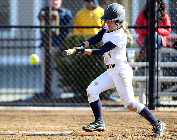 Endicott College freshman and Danvers native Chrissy Gikas (4) lines a single against Wentworth during a 5-run third inning for the Gulls. The Gulls swept the Leopards, (15-1, 12-1) on Wednesday afternoon. DAVID LE/Staff photo 4/2/14