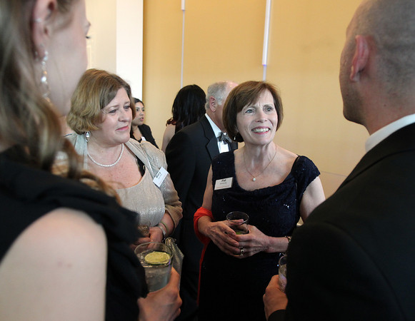 """Salem State University President Dr. Patricia Maguire Meservey, smiles while chatting with Phil and Nicole Lippens, and Mary DeChillo, second from left, during a gala held in the atrium of the Gassett Fitness Center on Saturday evening. The university announced the public phase of a $25 million campaign, the largest fundraising initiative ever taken by the university, and announced that they've already raised $15 million towards the goal in a private phase of the campaign, which they called """"10,000 reasons."""" DAVID LE/Staff photo. 4/12/14"""