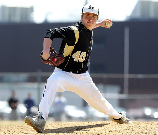 Bishop Fenwick pitcher _______ (40) throws a pitch against Peabody on Saturday afternoon. DAVID LE/Staff photo. 4/19/14