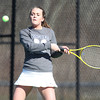 Pingree junior captain Casey Torto returns a volley while playing No. 2 singles against Masco during their match on Tuesday afternoon. DAVID LE/Staff photo 4/1/14