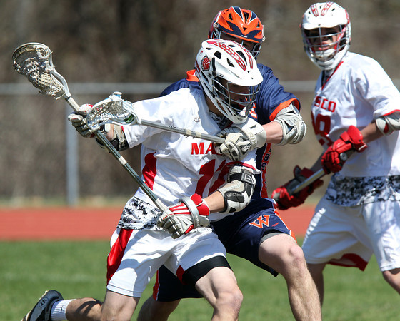 Masco sophomore midfielder Mitchell Godett (10) tries to create space with a Walpole defender draped over him during the second game of the Creator's Cup held at Masconomet Regional High School in Topsfield on Thursday afternoon. DAVID LE/Staff photo. 4/24/14