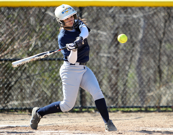Swampscott second baseman Christina King (16) lines a two-RBI triple to tie the game at 9-9 in the bottom of the 7th for the Big Blue. King scored the game-winning run on a passed ball to give the Big Blue a 10-9 walk off win over the Panthers in NEC action on Thursday afternoon. DAVID LE/Staff photo. 4/24/14