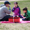 KEN YUSZKUS/Staff photo.  Bob Jones of Beverly and his daughter Devyn and son Zach have a noontime picnic at Dane Street Beach in Beverly. 4/22/14