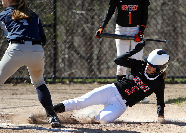 Beverly's Jackie Pia (5) slides safely into home as she scored on a passed ball as part of the Panthers 3-run 7th inning against Swampscott. The Big Blue rallied from three-runs down in the bottom of the 7th inn in for a 10-9 walk off win over the Panthers in NEC action on Thursday afternoon. DAVID LE/Staff photo. 4/24/14