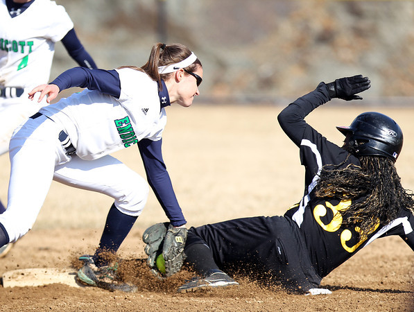 Endicott senior captain and shortstop Jesse Bilafer (15) tags out stealing Wentworth junior Anne Harris (33) to end the top of the second inning. The Gulls swept the Leopards, (15-1, 12-1) on Wednesday afternoon. DAVID LE/Staff photo 4/2/14