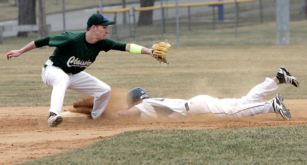 KEN YUSZKUS/Staff photo: Danvers' Andrew Olszak is safe on 2nd during the Lynn Classical at Danvers baseball game  in home opener at Twi Field at Plains Park.