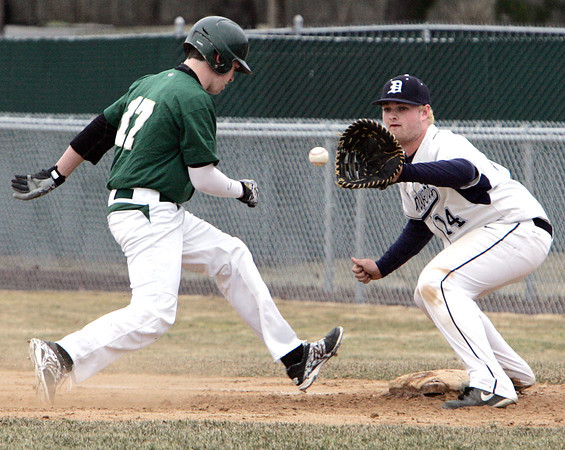 KEN YUSZKUS/Staff photo: Danvers' first baseman Devonn Allen gets the throw from pitcher 11 for a unsuccessful pick off try during the Lynn Classical at Danvers baseball game  in home opener at Twi Field at Plains Park.
