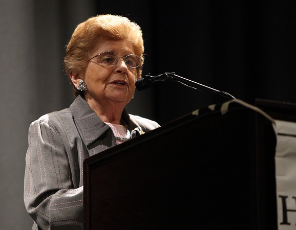 Rena Finder, a member of Schindler's List and a survivor of Auschwitz, speaks after receiving the Holocaust Center Service Award during Yom HaShoah 2014 held in the auditorium at Peabody Veterans Memorial High School on Monday evening. DAVID LE/Staff Photo. 4/28/14