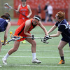 Beverly's Alicia Cecchini (2) battles for a loose ball with Peabody's Aly Bortone (7) and Courtney Smith (24) during the first half of play on Friday afternoon. DAVID LE/Staff photo. 4/11/14