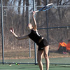 Ipswich High School senior captain and No. 2 singles player Lexi Lopez serves against Triton on Thursday afternoon. DAVID LE/Staff photo 4/3/14