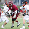 Gloucester's Jason Erwin (7) gets tangled up with Beverly's Graham Doherty (13) and Bryan Flaherty (33) during the second quarter of play on Thursday afternoon. DAVID LE/Staff photo. 5/1/14