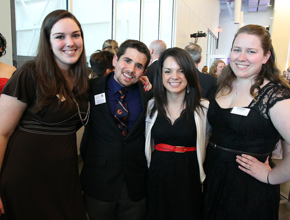 """From left: Salem State University senior Alisha Halpin, junior Andrew Visconti, graduate student Alexis Quintal, and sophomore Cheryl Goodney, at a gala held in the atrium of the Gassett Fitness Center on Saturday evening. The university announced the public phase of a $25 million campaign, the largest fundraising initiative ever taken by the university, and announced that they've already raised $15 million towards the goal in a private phase of the campaign, which they called """"10,000 reasons."""" DAVID LE/Staff photo. 4/12/14"""