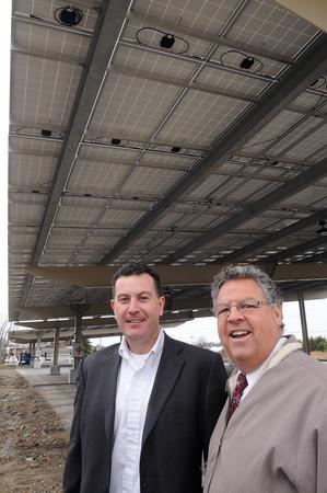 KEN YUSZKUS/Staff photo. Matt Fitzgerald of Old Salt Works Partners, left, and Danversport Yacht Club general manager Paul DeLorenzo stand under Danversport Yacht Club's new Solar parking canopy.