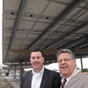 KEN YUSZKUS/Staff photo. Matt Fitzgerald of Old Salt Works Partners, left, and Danversport Yacht Club general manager Paul DeLorenzo stand under Danversport Yacht Club's new Solar parking canopy.