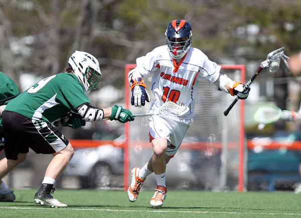 Salem State freshman midfielder Steve Hanley (10) jukes around Plymouth State freshman defense Tyler Hawley (9) and carries the ball upfield on Saturday afternoon. DAVID LE/Staff photo. 4/12/14