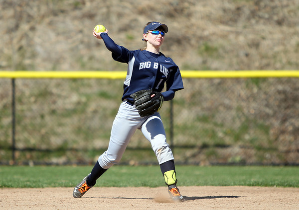 Swampscott shortstop Tori Thistle (1) fires to first to retire a Beverly runner. The Big Blue rallied from three-runs down in the bottom of the 7th inn in for a 10-9 walk off win over the Panthers in NEC action on Thursday afternoon. DAVID LE/Staff photo. 4/24/14