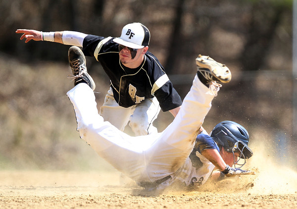 Bishop Fenwick senior shortstop Nick Bona reaches down and tags out Peabody runner Kevin Lebel, right, as he slides into second base on a steal attempt. DAVID LE/Staff photo. 4/19/14