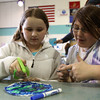 Carlton School fourth graders Isabella Beirus, and Brooke Foster, both 10, make a watercolor earth piece of art during the Carlton School's 3rd Annual Earth Day Fest in the cafeteria on Thursday evening. In addition to crafts and games, Ward Two Councilor Heather Famico and Ward Six Councilor Beth Gerard served as two judges for a recycled art competition and Whole Foods Market and Mass Auduban set up table to share some information with the students. DAVID LE/Staff photo. 4/17/14