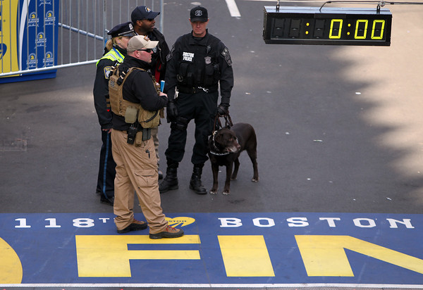 There was much increased security presence along Boylston Street and the entire Marathon route in light of the bombings from last year's Boston Marathon.  DAVID LE/Staff photo 4/21/14