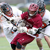 Beverly senior Graham Doherty, left, and junior Bryan Flaherty, right, sandwich Gloucester midfielder Jason Erwin as he possess the ball during the second quarter of play on Thursday afternoon. DAVID LE/Staff photo. 5/1/14