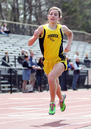 Bishop Fenwick senior captain Arianna Maida wins the 800 meter race in a dual meet against St. Mary's (Lynn) and Cathedral on Tuesday morning at Bishop Fenwick High School in Peabody. DAVID LE/Staff photo. 4/22/14