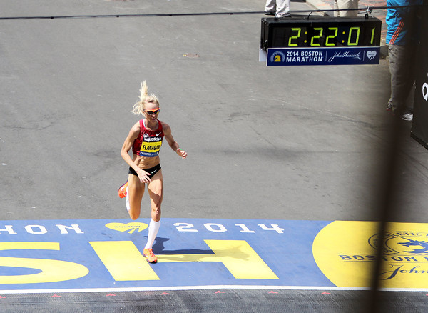 Marblehead native Shalane Flanagan closes in on her finals steps in the 118th Boston Marathon as she finished in a personal best time of 2:22:02, good enough for 7th place overall. DAVID LE/Staff photo 4/21/14