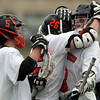 Beverly junior attack Nick Albano (8) celebrates his second quarter goal with senior Nick Donovan (26) and freshman Sam Abate (5). DAVID LE/Staff photo 4/15/14
