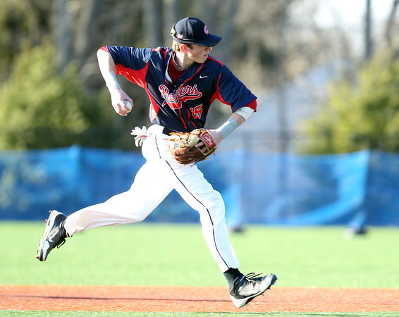 Central Catholic shortstop Cam Devanney (15) fires an off balance throw to first to retire the side against St. John's Prep in the bottom of the 4th. The Raiders fell to the Eagles 9-3 at St. John's Prep in Danvers on Thursday afternoon. DAVID LE/Staff photo 4/10/14