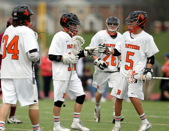 Beverly freshman Sam Abate (5) and sophomore Jordan Rawding (34) come over to celebrate sophomore Hunter Spencer's (12) first quarter goal against Gloucester on Thursday afternoon. DAVID LE/Staff photo. 5/1/14