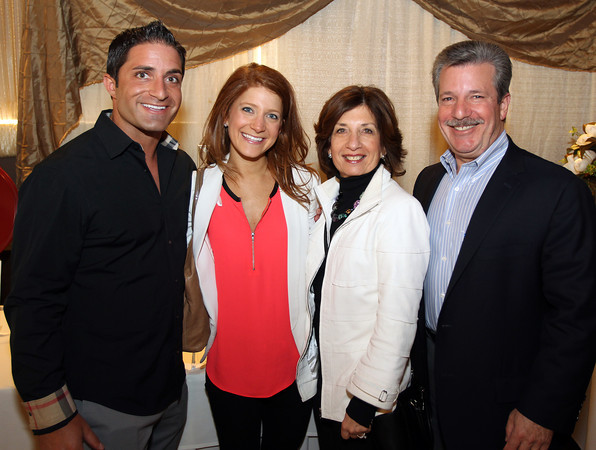 From left: Dan Marino, of Boston, and Jen, Francine, and Al Temkin, of Beverly, at the 6th annual North Shore Star singing competition hosted by the Beverly Rotary Club and North Shore Music Theatre held at the Danversport Yacht Club on Friday evening. DAVID LE/Staff photo. 4/25/14