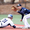Peabody first baseman Michael Petrosino (5) waits for a pickoff throw as St. John's Prep junior Ted McNamara (21) slides headfirst back into the bag on Saturday afternoon. DAVID LE/Staff photo 4/5/14