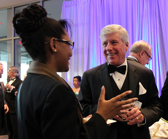 """Henry Bortolon, a member of the Campaign Steering Committee for Salem State University, talks with Salem State freshman Victoria Plummer, left, during a gala held in the atrium of the Gassett Fitness Center on Saturday evening. The university announced the public phase of a $25 million campaign, the largest fundraising initiative ever taken by the university, and announced that they've already raised $15 million towards the goal in a private phase of the campaign, which they called """"10,000 reasons."""" DAVID LE/Staff photo. 4/12/14"""
