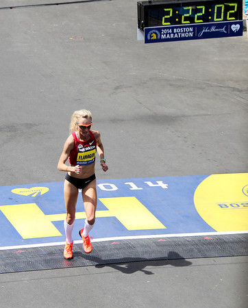 Marblehead native Shalane Flanagan crosses the finish line of the 118th Boston Marathon in a personal best time of 2:22:02 on Monday morning. Flanagan placed 7th overall in the Elite Women's Race. DAVID LE/Staff photo 4/21/14