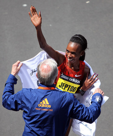 Rita Jeptoo, back-to-back winner of the Boston Marathon waves to the thousands cheering her on at the finish line after she set a course record (2:18:57) on Monday morning in the 118th running of the race. DAVID LE/Staff photo 4/21/14