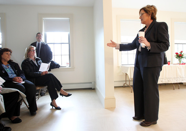 Cynthia Dunn, Executive Director of the Danvers Housing Authority thanks Senator Joan Lovely (seated middle) for attending the dedication and opening of the two-family affordable housing building at 24 Cherry Street in Danvers on Wednesday morning. DAVID LE/Staff photo. 4/30/14