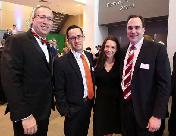 "From left: Jim Muse, Jon and Katie Knochel, and Jeff LaCross, at a gala held in the atrium of the Gassett Fitness Center on Saturday evening. The university announced the public phase of a $25 million campaign, the largest fundraising initiative ever taken by the university, and announced that they've already raised $15 million towards the goal in a private phase of the campaign, which they called ""10,000 reasons."" DAVID LE/Staff photo. 4/12/14"