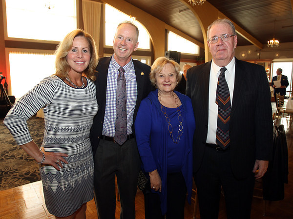 From left: Incoming Beverly Rotary Club President Rick Mooney, and his wife JoAnna, and current Rotary President Joe Bubriski, and his wife Judy, at the 6th annual North Shore Star singing competition hosted by the Beverly Rotary Club and North Shore Music Theatre held at the Danversport Yacht Club on Friday evening. DAVID LE/Staff photo. 4/25/14