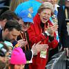 Senator Elizabeth Warren cheers on finishers of the 118th Boston Marathon on Monday morning. DAVID LE/Staff photo 4/21/14