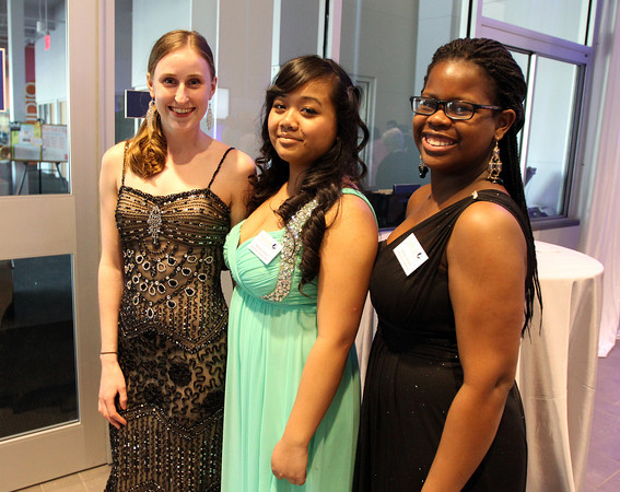"""From left: Salem State graduate student Jen Allen, junior Melissa Soeur, and sophomore Ashley Gordon, at a gala held in the atrium of the Gassett Fitness Center on Saturday evening. The university announced the public phase of a $25 million campaign, the largest fundraising initiative ever taken by the university, and announced that they've already raised $15 million towards the goal in a private phase of the campaign, which they called """"10,000 reasons."""" DAVID LE/Staff photo. 4/12/14"""