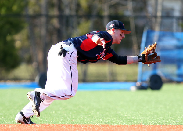 Central Catholic second baseman Cody Demers (22) makes a lunging grab on a grounder and throws to first to retire a St. John's Prep batter. The Raiders fell to the Eagles 9-3 at St. John's Prep in Danvers on Thursday afternoon. DAVID LE/Staff photo 4/10/14