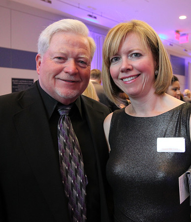 """Stephen and Pam Doherty at a gala held in the atrium of the Gassett Fitness Center on Saturday evening. The university announced the public phase of a $25 million campaign, the largest fundraising initiative ever taken by the university, and announced that they've already raised $15 million towards the goal in a private phase of the campaign, which they called """"10,000 reasons."""" DAVID LE/Staff photo. 4/12/14"""