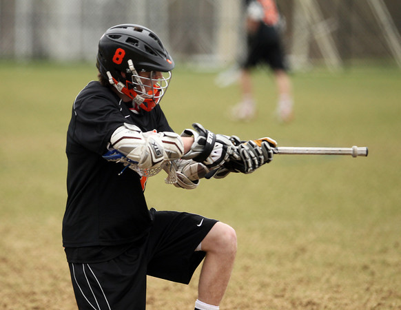 Beverly junior attack Nick Albano celebrates his third quarter goal against Danvers on Monday afternoon. DAVID LE/Staff Photo. 4/28/14
